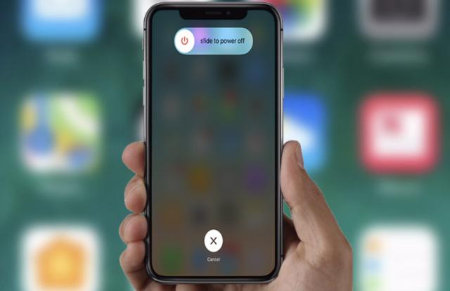 Khởi động lại iPhone để kiểm tra tín hiệu nhận sim ghép